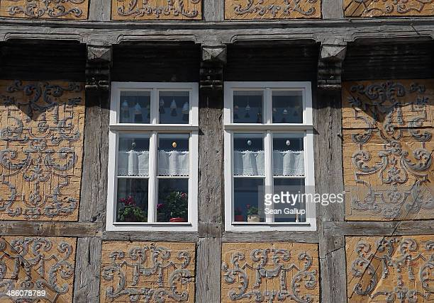 Intricate designs decorate a halftimbered house on April 20 2014 in Quedlinburg Germany Quedlinburg located in the Harz region dates its history to...