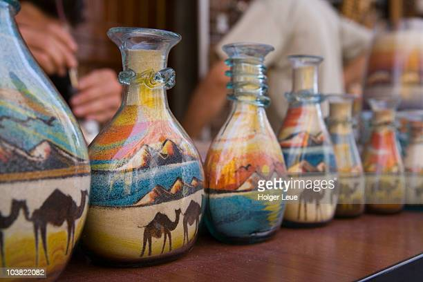 intricate sand painting souvenirs. - painting art product stock pictures, royalty-free photos & images
