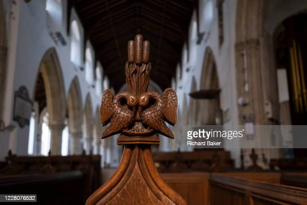 Intricate wooden carvings on the end of pews in the Church of St. Michael's, on 10th August 2020, in Aylsham, Norfolk, England. The Church of St...