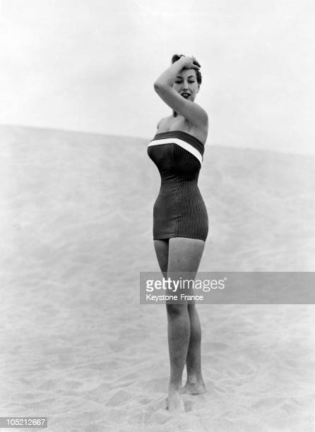 Introducing A New Style One Piece Swimsuit Consisting Of A Bustier Attached To A Little Skirt In The 1930S In Hollywoo