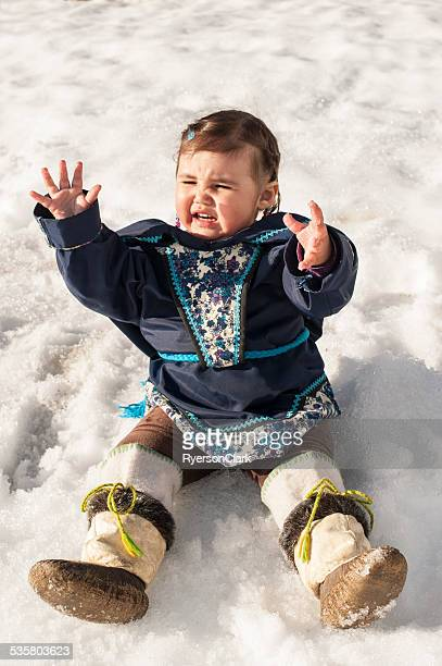 Inuit Child in the Snow, Baffin Island, Nunavut, Canada.