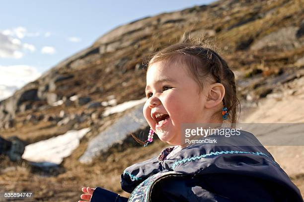 inuit child in the snow, baffin island, nunavut, canada. - inuit stock pictures, royalty-free photos & images