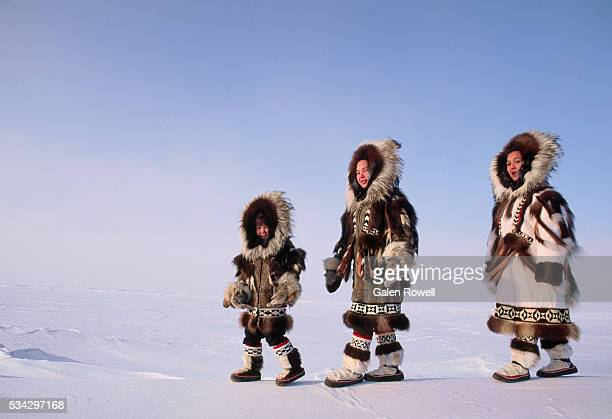 inuit children in winter furs - inuit stock pictures, royalty-free photos & images