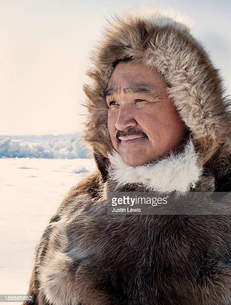 Inuit hunter in reindeer fur jacket on ice