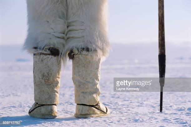 inuit hunter wearing seal skin boots - hunting stock pictures, royalty-free photos & images
