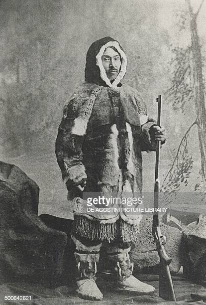 Inuit in traditional clothes with shotgun, Canada, 19th century. Yellowknife, Prince Of Wales Northern Heritage Centre