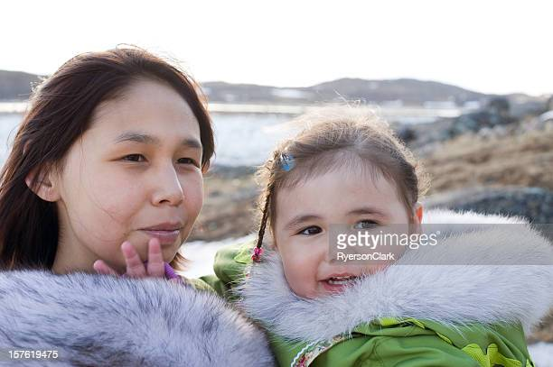 inuit mother and daughter baffin island, nunavut. - inuit stock pictures, royalty-free photos & images