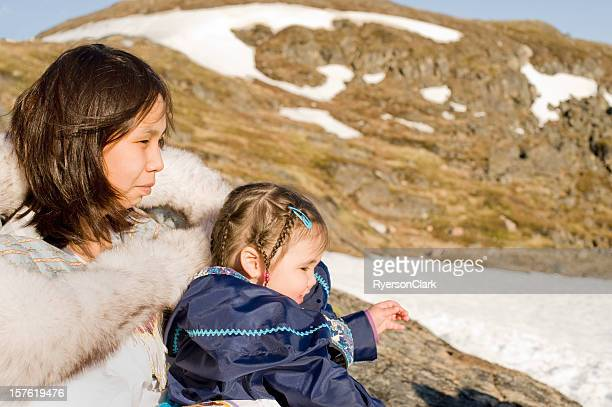 inuit mother and daughter in traditional parkas, nunavut. - first nations stock pictures, royalty-free photos & images