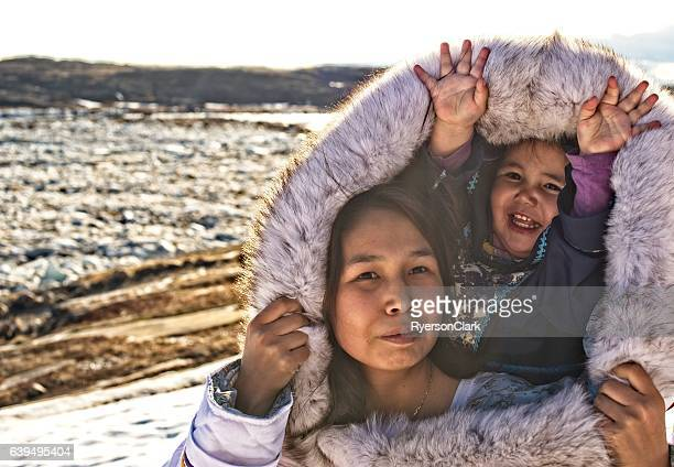 inuit mother and daughter on baffin island, nunavut, canada. - inuit stock pictures, royalty-free photos & images