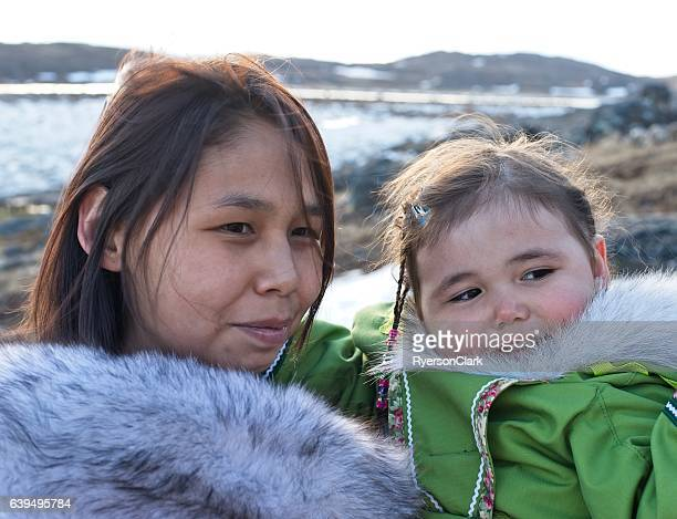 Inuit mother and daughter on Baffin Island, Nunavut, Canada.