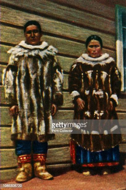 Inuit people from Alaska northern USA circa 1928 Couple wearing clothes made of seal fur From 'Die Welt in Bildern' cigarette card album circa 1928...