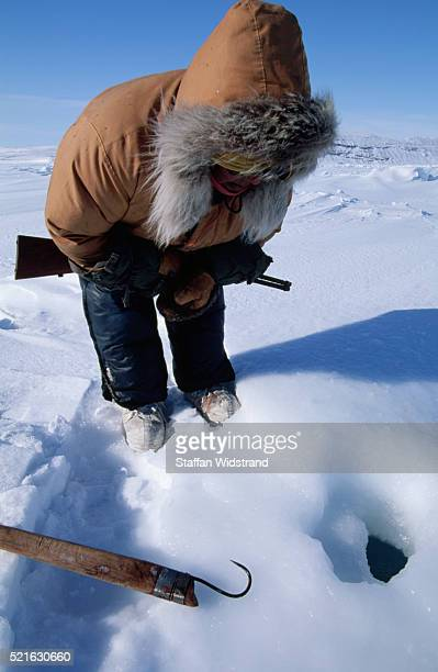 Inuit Seal Hunter Watching a Seal's Breathing Hole