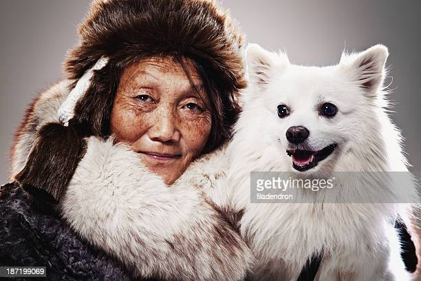 inuit woman and dog - inuit stock pictures, royalty-free photos & images
