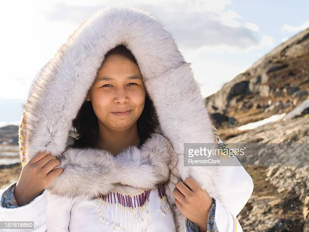 inuit woman in traditional dress on baffin island - inuit stock pictures, royalty-free photos & images