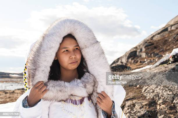 inuit woman on the tundra of baffin island, nunavut, canada. - inuit stock pictures, royalty-free photos & images