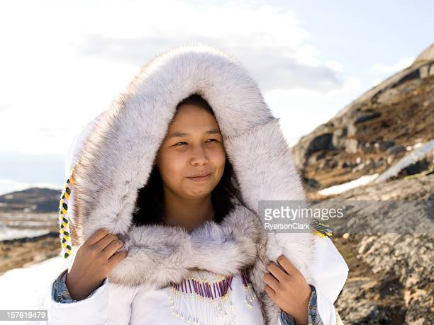 inuit woman on the tundra. - inuit stock pictures, royalty-free photos & images