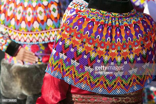 inuit women wearing traditional greenlandic national costume or kalaallisuut in ilulissat on greenland. the costume consists of seal skin boots(unnaat) bead necklaces (nuilaqutit) and seal skin trousers (takisut) - inuit stock-fotos und bilder