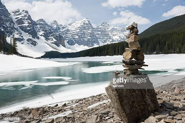 inukshuk, stacked stones at moraine lake - inuit stock pictures, royalty-free photos & images