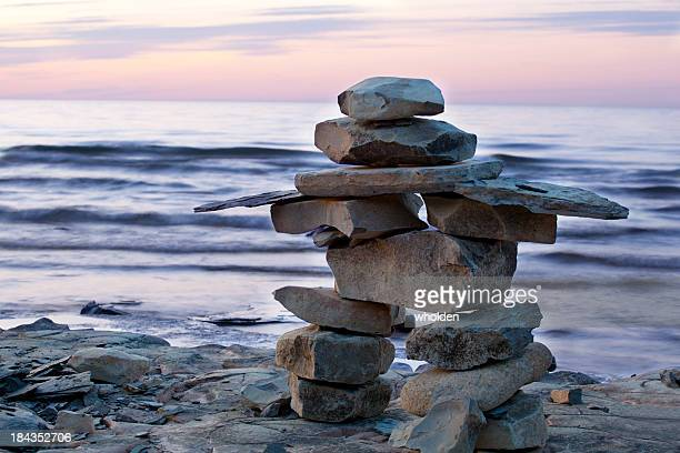 inuksuk at sunset - indigenous culture stock pictures, royalty-free photos & images