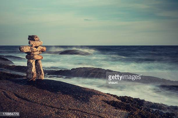 inuksuk by the sea - inuit stock pictures, royalty-free photos & images