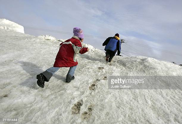 Inupiat eskimo children play along the banks of the frozen Arctic Ocean June 7 2006 in Browerville Alaska Scientists continue to study changes in the...