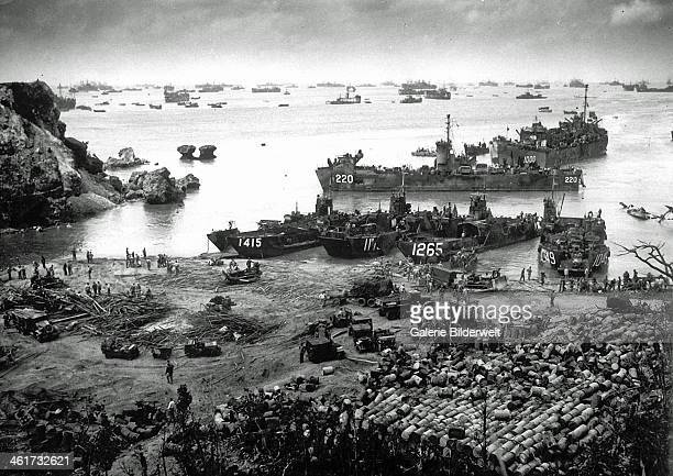 US invasion forces establish a beachhead on Okinawa island about 350 miles from the Japanese mainland 13th April 1945 Pouring out war supplies and...