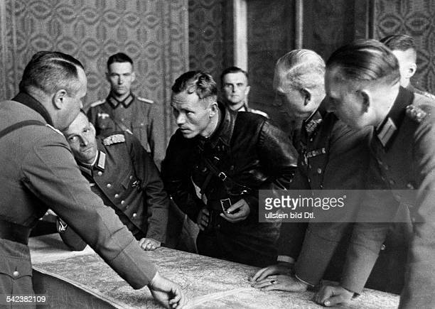 2WW Invasion of Poland 0109German and Soviet military units meet at BrestLitowsk Soviet political commisssioner and german officers in debate