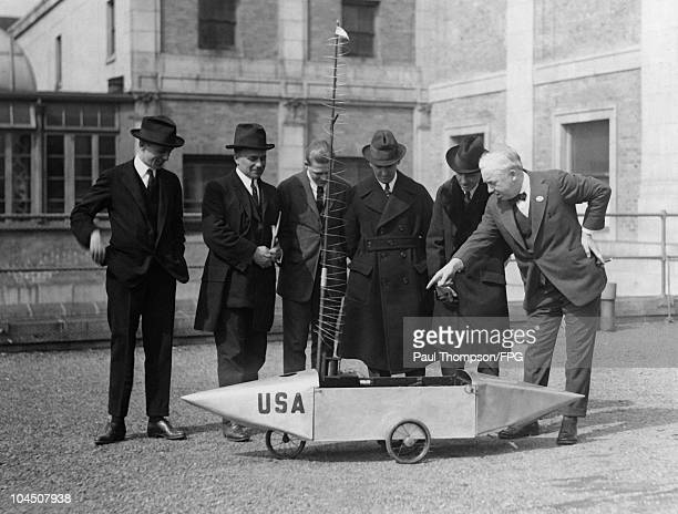 Inventor Edwin Slavin at the Radio Show in Pennsylvania with his invention the wireless controlled torpedo car circa 1940s