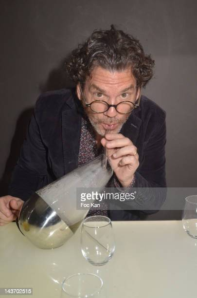 HH inventor/ Le Laboratoire fundator David Edwards poses with a 'WAF' flavouring smoke bottle during the 'WAA/HH' Food Flavouring Spray By Philippe...