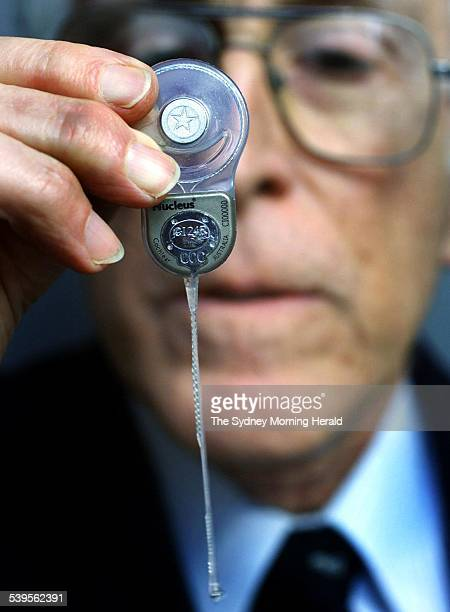 Inventor of the Nucleus Cochlear Implant Professor Graeme Clark during a press conference holding one of the Australian made devices 26 July 2002 SMH...