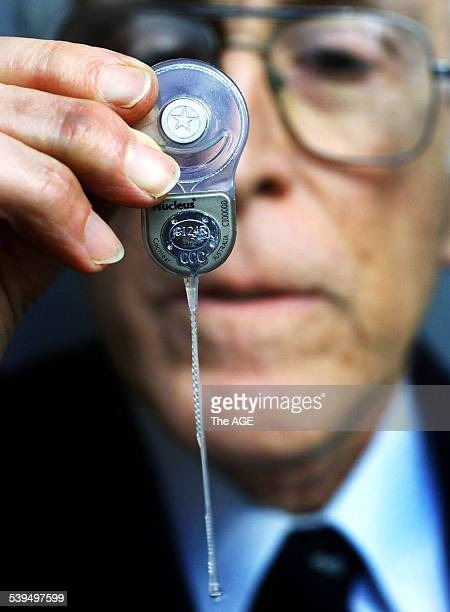 Inventor of the Nucleus Cochlear Implant Professor Graeme Clark during his press conference Holding one of the Australian made devices 26 July 2002...