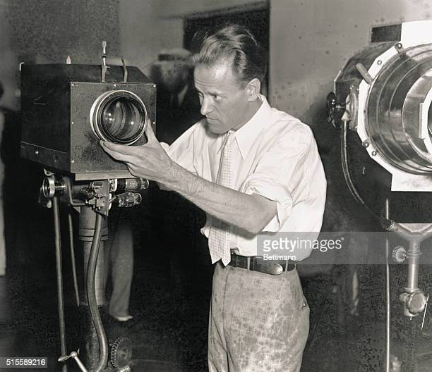 Inventor Philo T Farnsworth adjusts a television camera during a demonstration of his television system at the Franklin Institute in Philadelphia