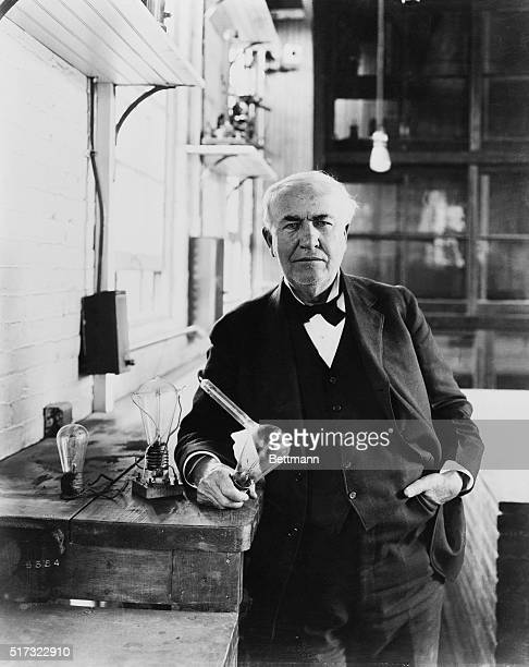 Inventor Thomas Alva Edison shows the incandescent lamps he created at his Menlo Park laboratory in New Jersey While Edison did not invent the idea...