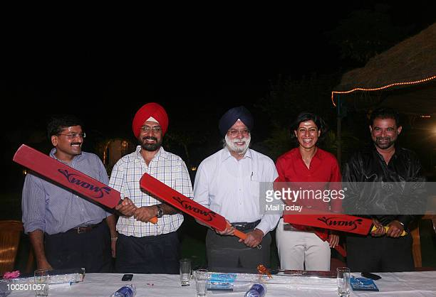 Inventor Vivek Lakhotia former test player Gursharan Singh lawyer KTS Tulsi with cricketers Anjum Chopra and Chetan Sharma at the launch of the 'Wow'...