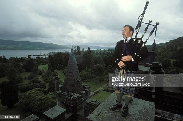 Inveraray Castle Chief of Campbell clan in United Kingdom in June 1994 The Duke's bagpipe player on the castle roof