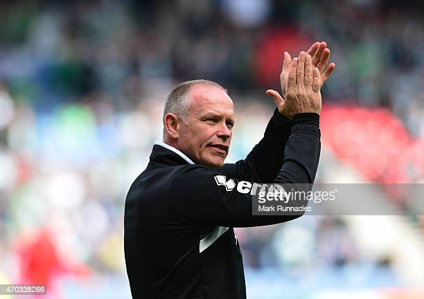 Inverness Caledonian Thistle manager John Hughes applauds during the William Hill Scottish Cup Semi Final match between Inverness Caledonian Thistle...
