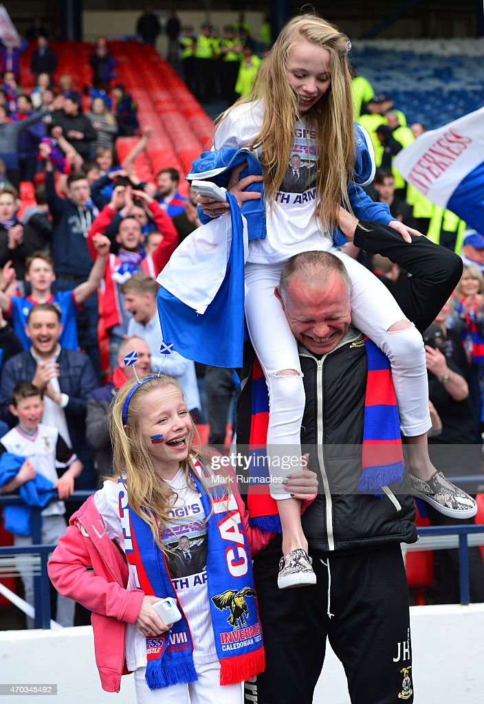 Inverness Caledonian Thistle manager John Hughes celebrates his teams famous victory over Celtic with his twin daughters Jessica and Victoria on during the William Hill Scottish Cup Semi Final match between Inverness Caledonian Thistle and Celtic at Hamden Park on April 19, 2015 in Glasgow Scotland.