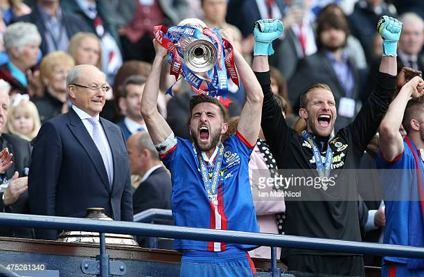 Inverness captain Graeme Shinnie lifts the cup after his team's victory in the William Hill Scottish Cup Final match between Falkirk and Inverness...