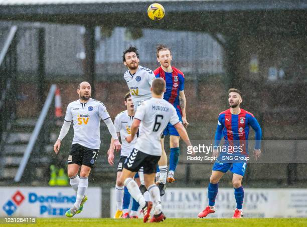 Inverness' David Carson and Ayr's Joe Chalmers challenge for a ball in the rainy conditions during a Scottish Championship match between Ayr United...