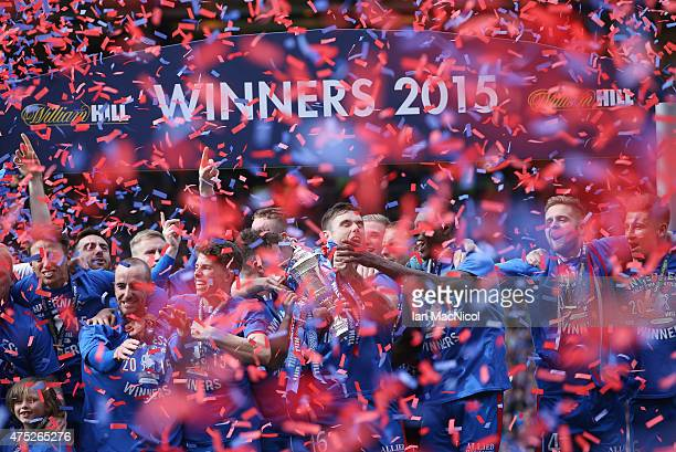 Inverness players lift the cup as they celebrate their victory in the William Hill Scottish Cup Final match between Falkirk and Inverness Caledonian...