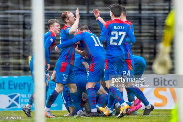 Inverness' Shane Sutherland is mobbed by his teammates after making it 2-0 with David Carson during a Scottish Championship match between Ayr United...
