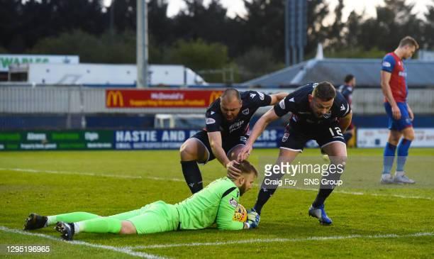 Ross County goalkeeper Scott Fox clings onto the ball after saving InvernessÕ Jordan WhiteÕs first half penalty as Kenny van de Weg and Andrew...