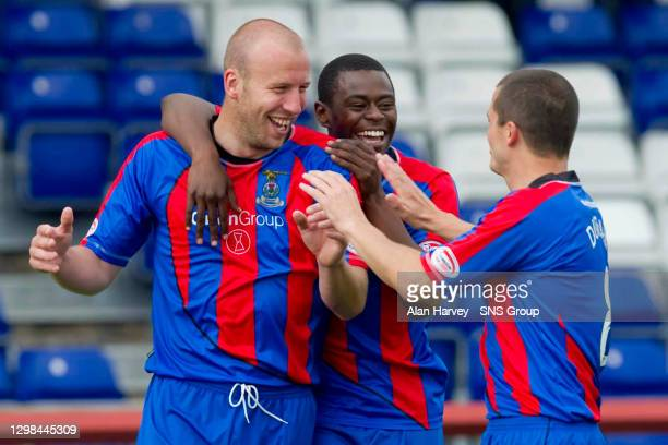 Ross Tokeley celebrates with team mates Eric Odhiambo and Russell Duncan after scoring to increase Inverness CT's advantage to three goals