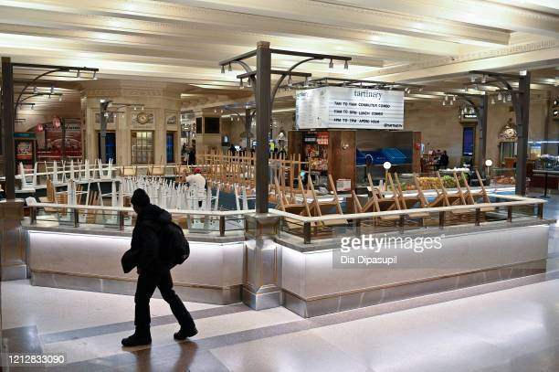 Inverted chairs are seen at the closed Tartinery cafe in Grand Central Terminal during rush hour as the coronavirus continues to spread across the...