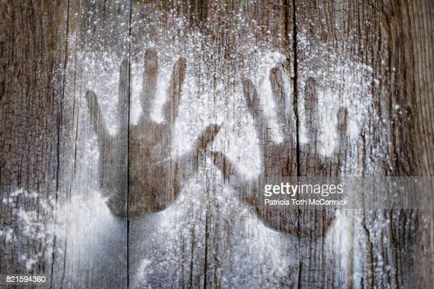 Inverted Hand Prints on Wood