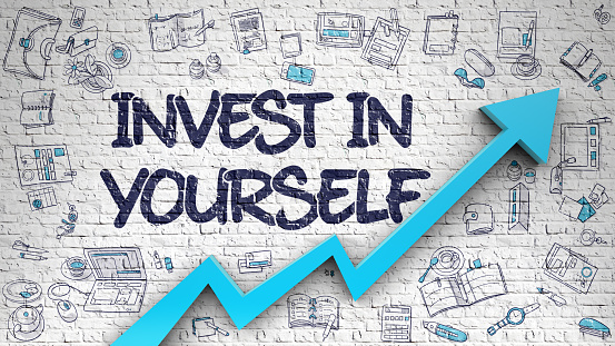 Invest In Yourself Drawn on White Brick Wall. 3D 687209536
