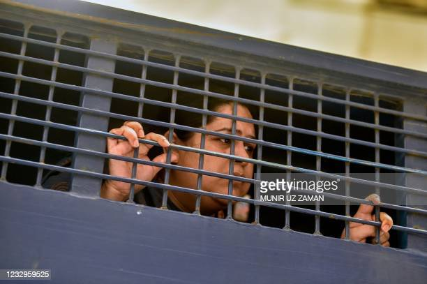 Investigative journalist Rozina Islam is seen inside a prison van in Dhaka on May 18 a day after being arrested on accusation of stealing documents...