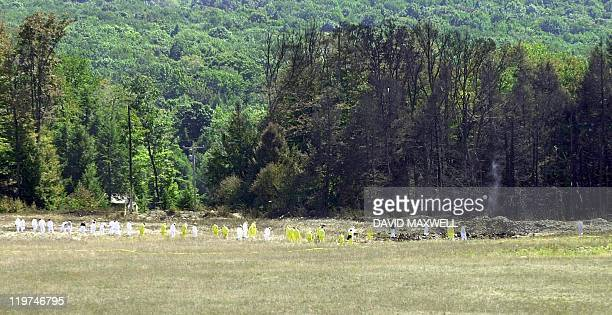 Investigative personnel search the crash site of United Airlines Flight 93 looking for debris and evidence including the plane's flight recorder 12...