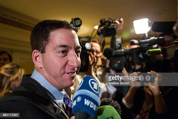 Investigative reporter Glenn Greenwald who worked with National Security Agency leaker Edward Snowden speaks to the media before accepting the George...