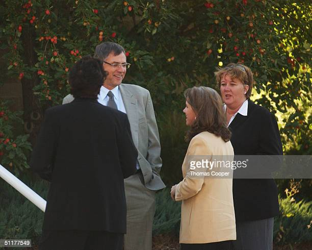 Investigator Rivka Morgan Sherman Attorney Hal Haddon Pamela Mackey and Security officer Kym Stewart talk outside the Eagle County Justice Center...